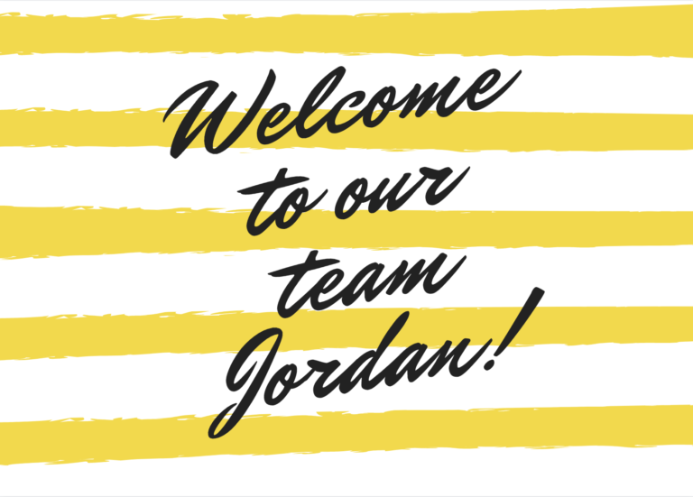 White and yellow striped sign welcoming Jordan to the team